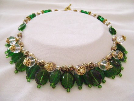 Emerald Green Stone, Crystal & Glass Beads Combine in This Bib Necklace With Clear & Gold Tone Accents.