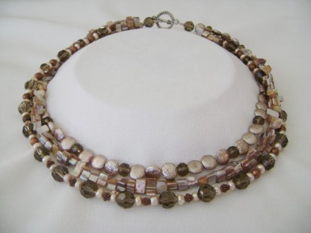 Made With Taupe Crystals, Pearls, And  Button & Other Shapes Made From Natural Materials.