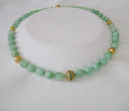 Jade Beads With Genuine Gold Accents. $250.00