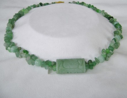 Jade Chips Woven Together With A Lovely Textured Jade Bar As The Focal point.