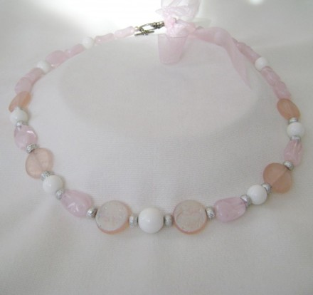 Moon Faces On Disc Shaped Pink Beads Adds Charm To This Necklace. $ 28.00