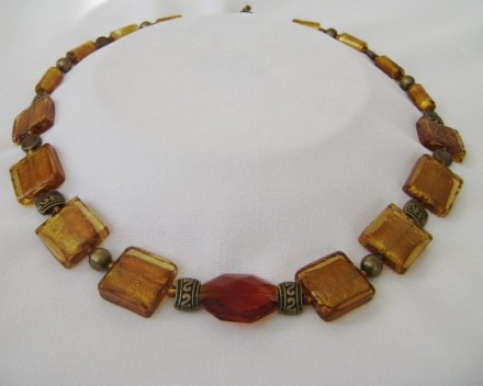 "This Necklace Appears To Change With The Light. Amber Colored Large Glass Squares & Beads 24"" Necklace with Bronze Toggle Closure $78"