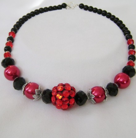 A Variety of Materials Were Used To Create This Fashionable Necklace.